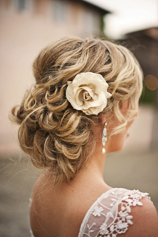 Photo of Bride with hair half up and flower