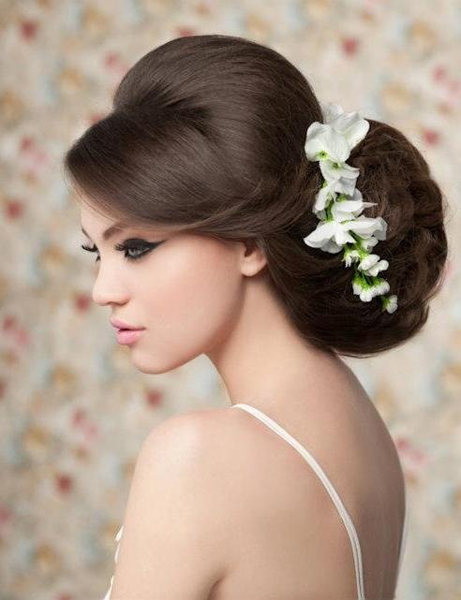 Phot of bride with hair up and small flowers