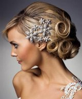 Photo of bride with small silver flowers in hair up
